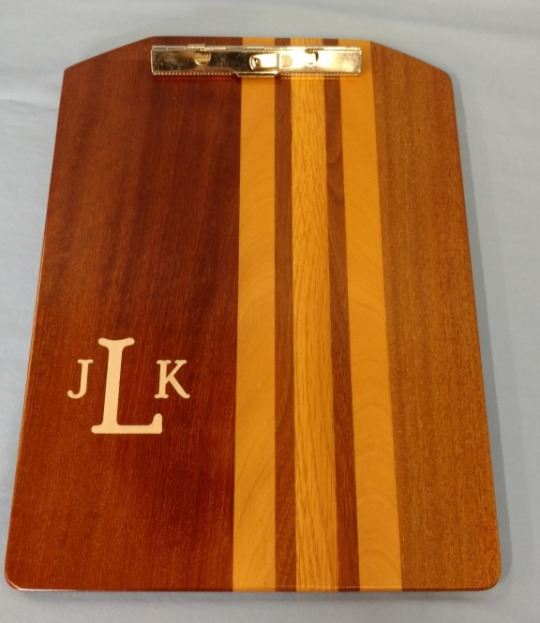 clip board laminated from various hard woods. personalized with inlaid monogram.