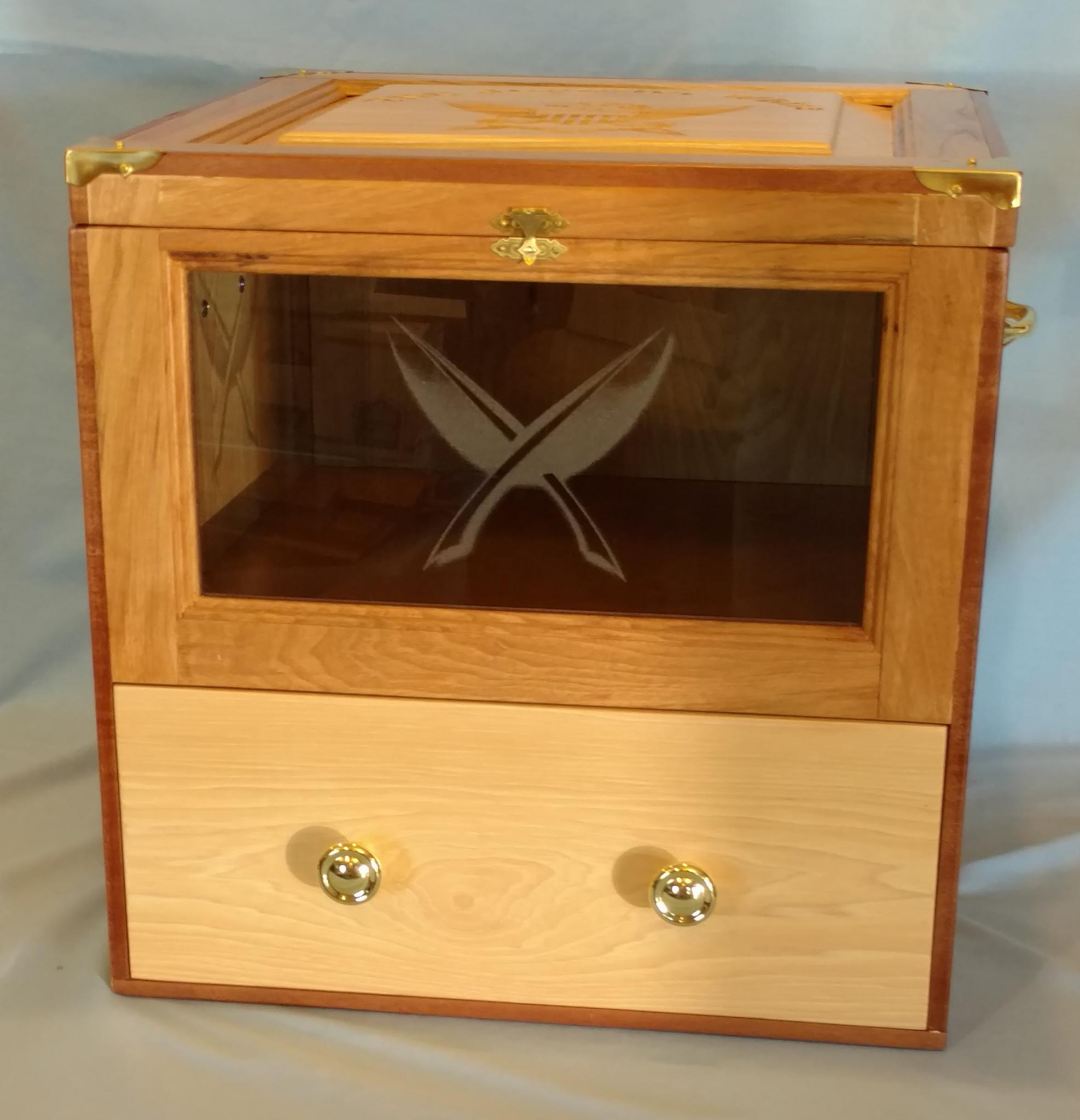 Most of the hat boxes have been designed just for the hat. A recent design included slots to display military coins along the inside walls. Another design included a drawer for the log book.