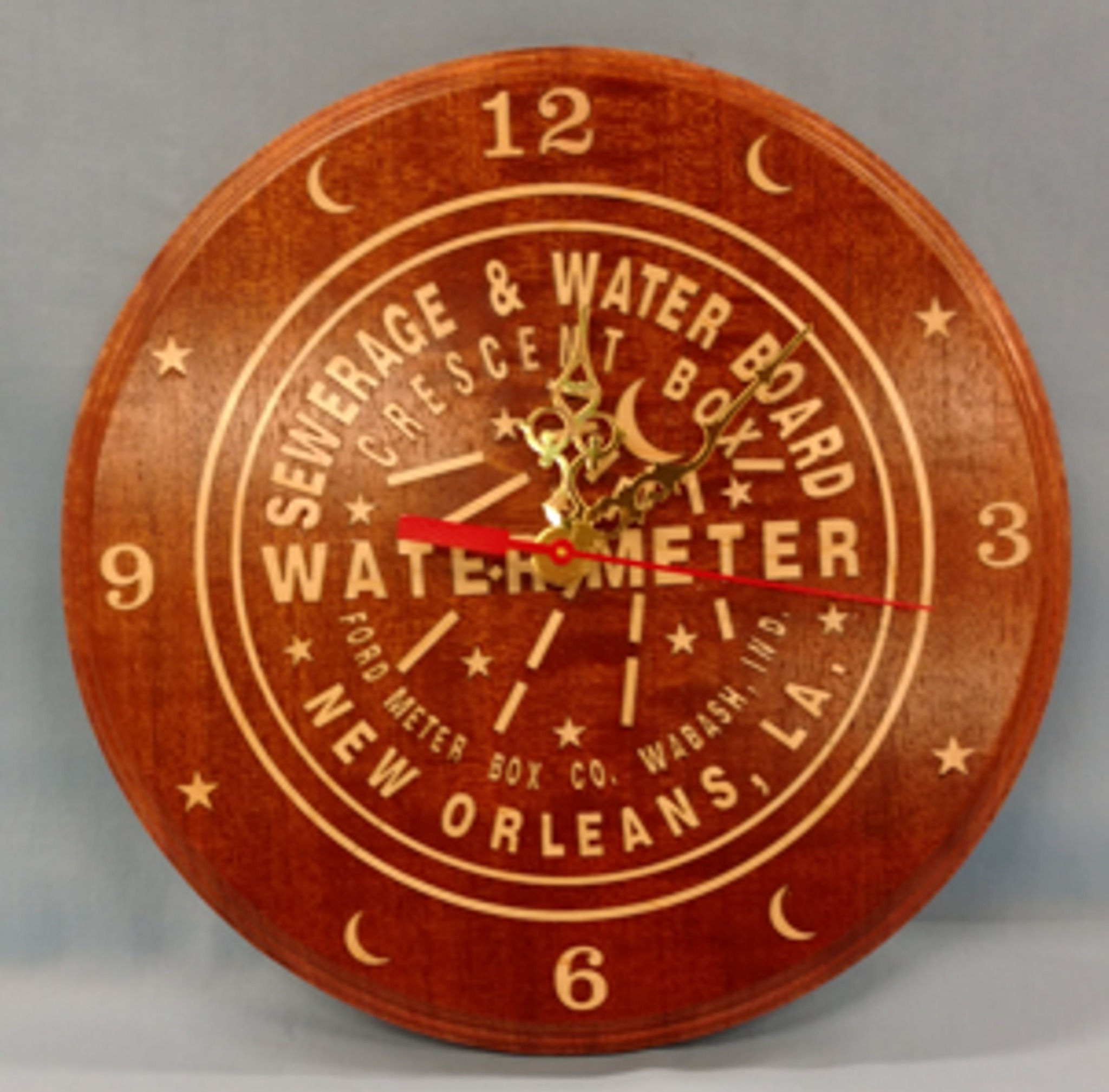 "Water meter clocks have been quite popular. They are normally 10"" round and laser engraved. Optionally, they may be fully inlaid or have inlaid numbers and symbols."