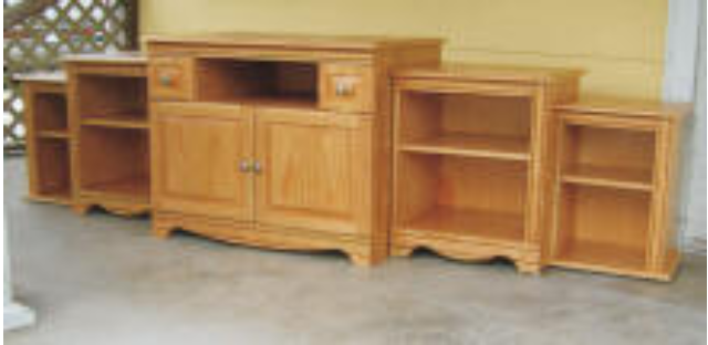 The TV cabinet was a hurricane Katrina reconstruction project. The design was taken from photographs of the destroyed cabinet.