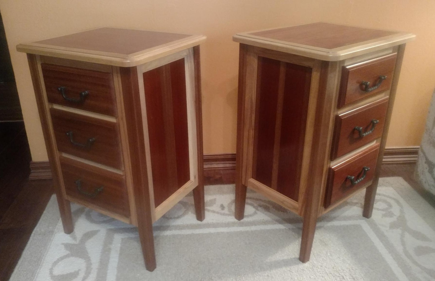 The end tables are made of mahogany and maple. The finish is clear satin lacquer.
