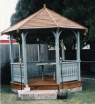 The gazebo was inspired by a woodworking project book. The basic structural design was taken from the plans. The roof and railing are design modifications. The brick enclosure was added to keep critters from finding a home.