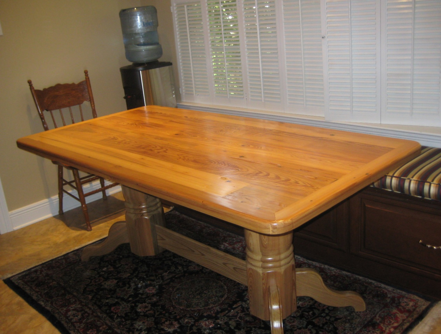 The table top was made from old cypress lumber that came from a torn down barn that was owned by the client's father. The base was built from sinker cypress since there wasn't enough lumber for the entire table.