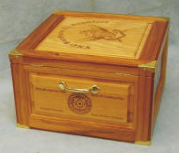 hickory/pecan hat box with coast guard path engraved on side.