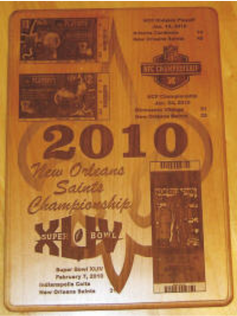 The commemorative plaque is a collage made from engravings of the playoff tickets and Super Bowl ticket.